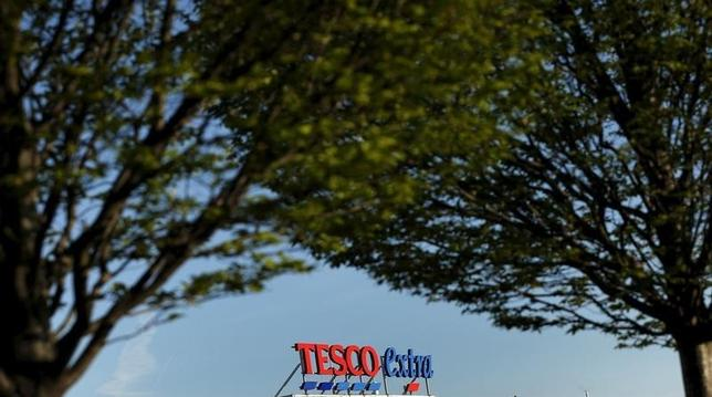 A sign is seen on the roof of a Tesco supermarket in Altrincham, northern England, April 22, 2015.  REUTERS/Phil Noble
