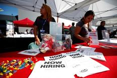 Recruiters wait at a booth at a military veterans' job fair in Carson, California October 3, 2014. REUTERS/Lucy Nicholson