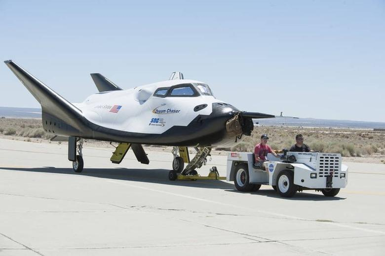Sierra Nevada Corporation engineers and technicians prepare the firm's Dream Chaser engineering test vehicle for tow tests on a taxiway at NASA's Dryden Flight Research Center in Palmdale, California on June 27, 2013. REUTERS/Ken Ulbrich/NASA/Handout