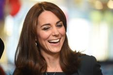 Britain's Catherine, Duchess of Cambridge, smiles as she attends a charity event at city company ICAP, in central London, Britain December 9, 2015. REUTERS/Jeremy Selwyn/pool