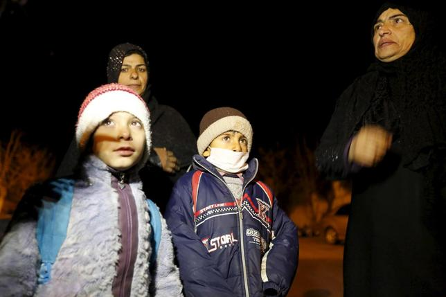Residents who say they have received permission from the Syrian government to leave the besieged town, depart after an aid convoy entered Madaya, Syria, January 11, 2016.    REUTERS/Omar Sanadiki