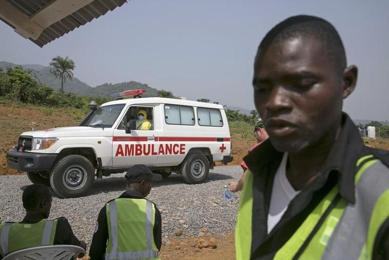 File image of an ambulance transporting a  Ebola patient drives to the entrance of the Save the Children Kerry Town Ebola treatment centre outside Freetown, Sierra Leone, December 22, 2014. REUTERS/Baz Ratner
