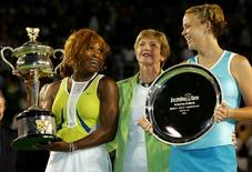 Former tennis great Margaret Court stands between Serena Williams and Lindsay Davenport after the trophy presentation at the 2005 Australian Open tennis tournament in Melbourne. REUTERS/David Gray