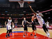 Jan 16, 2016; Los Angeles, CA, USA; Sacramento Kings center DeMarcus Cousins (15) scores past Los Angeles Clippers center Cole Aldrich (45) during the first half at Staples Center. Mandatory Credit: Robert Hanashiro-USA TODAY Sports