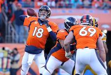 Jan 17, 2016; Denver, CO, USA; Denver Broncos quarterback Peyton Manning (18) throws against the Pittsburgh Steelers during the second quarter of the AFC Divisional round playoff game at Sports Authority Field at Mile High. Mandatory Credit: Matthew Emmons-USA TODAY Sports