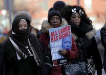 People take part in a march following the National Action Network (NAN) Dr. Martin Luther King, Jr. Day Public Policy Forum in the Harlem section of New York January 18, 2016. REUTERS/Brendan McDermid