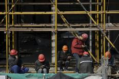 Workers rest after lunch at a construction site in Shanghai, China, January 19, 2016. REUTERS/Aly Song