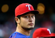 Texas Rangers starting pitcher Yu Darvish (11) looks on before the game against the Detroit Tigers at Globe Life Park in Arlington. Mandatory Credit: Kevin Jairaj-USA TODAY Sports