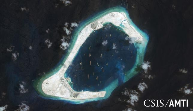 Subi reef, located in the disputed Spratly Islands in the South China Sea, is shown in this handout Center for Strategic and International Studies (CSIS) Asia Maritime Transparency Initiative satellite image taken September 3, 2015 and released to Reuters October 27, 2015. REUTERS/CSIS Asia Maritime Transparency Initiative/DigitalGlobe/Handout via Reuters/Files