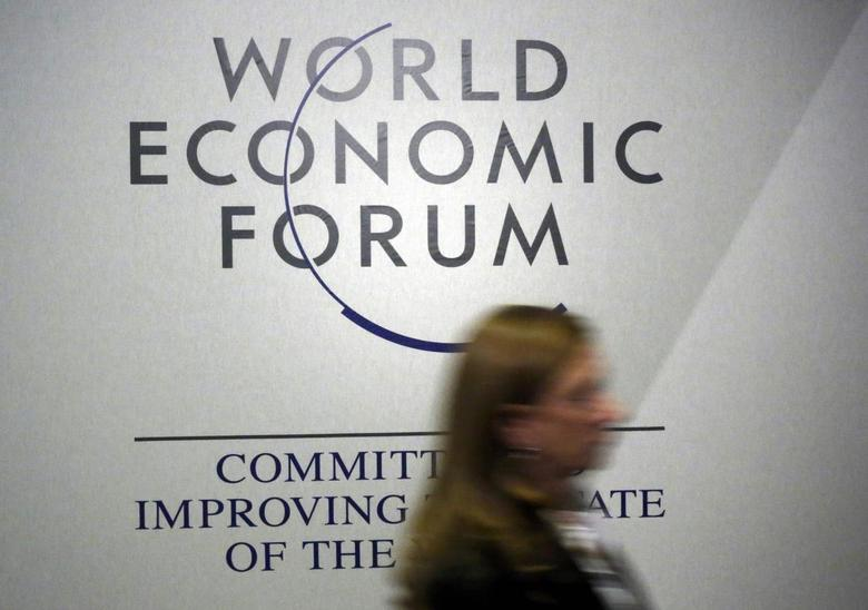 A person passes by a logo of the World Economic Forum (WEF) in the congress centre during the annual meeting of the World Economic Forum (WEF) in Davos, Switzerland January 20, 2016.  REUTERS/Ruben Sprich