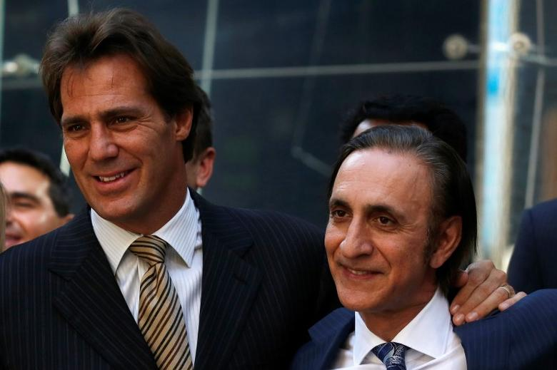 FireEye Inc. Chairman and CEO David DeWalt (L) and Founder Ashar Aziz pose together outside the Nasdaq Market site in Times Square following the company's debut on the Nasdaq exchange in New York, September 20, 2013. REUTERS/Brendan McDermid