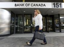 A woman walks past the Bank of Canada office in Ottawa, Canada July 16, 2015. REUTERS/Chris Wattie