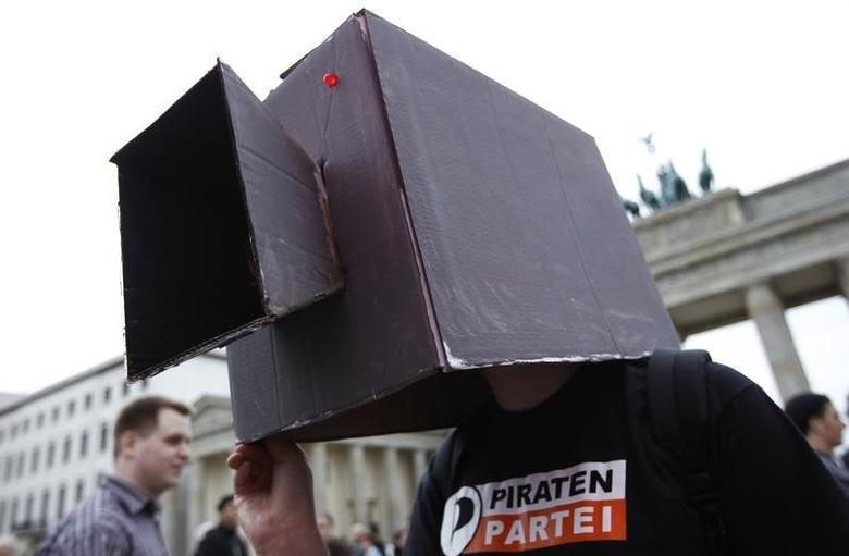 A Piraten Partei (Pirate Party) supporter wears a mock CCTV camera as he stands in front of Brandenburg Gate during the ''Freiheit Statt Angst'' (Freedom instead of Fear) protest calling for the protection of digital data privacy in Berlin, September 10, 2011.   REUTERS/Thomas Peter