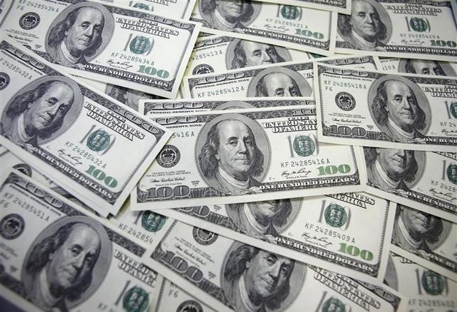 1月21日、午後3時のドル/円は、前日ニューヨーク市場午後5時時点に比べ、ドル安/円高の116.79/81円だった。ソウルで2011年9月撮影(2016年 ロイター/Lee Jae Won)