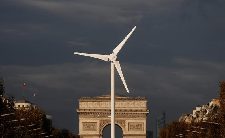 A power-generating windmill turbine is seen in front of the Arc de Triomphe on the Champs Elysees avenue in Paris. REUTERS/Christian Hartmann
