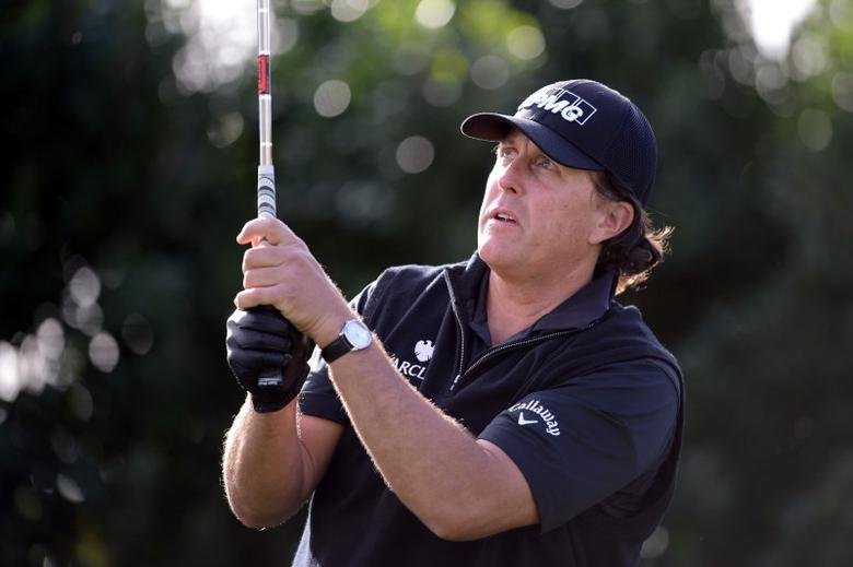 Jan 21, 2016; La Quinta, CA, USA; Phil Mickelson watches his tee shot on the 2nd hole during the first round of the CareerBuilder Challenge at La Quinta Country Club.  Mandatory Credit: Joe Camporeale-USA TODAY Sports