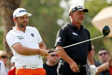 Golf - Abu Dhabi HSBC Golf Championship - Abu Dhabi Golf Club, United Arab Emirates - 22/1/16 England's Andy Sullivan tees off at the 18th hole watched by Northern Ireland's Darren Clarke during the second round Action Images via Reuters / Paul Childs Livepic