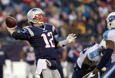 Dec 20, 2015; Foxborough, MA, USA; New England Patriots quarterback Tom Brady (12) throws a pass against the Tennessee Titans in the second half at Gillette Stadium.  David Butler II-USA TODAY Sports