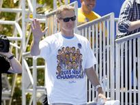 Jun 19, 2015; Oakland, CA, USA; Head coach Steve Kerr waves to the crowd during the Golden State Warriors 2015 championship celebration in downtown Oakland. Mandatory Credit: Cary Edmondson-USA TODAY Sports