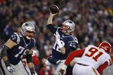Jan 16, 2016; Foxborough, MA, USA; New England Patriots quarterback Tom Brady (12) throws the ball for a touchdown against the Kansas City Chiefs during the second half in the AFC Divisional round playoff game at Gillette Stadium. Mandatory Credit: David Butler II-USA TODAY Sports
