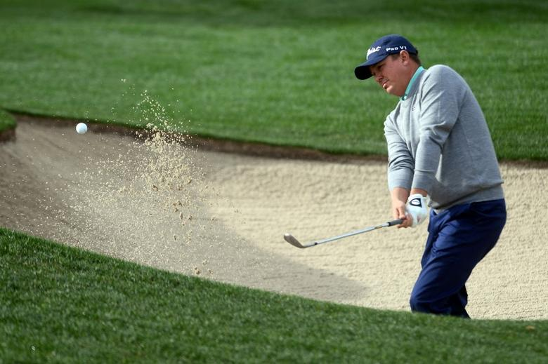 Jan 23, 2016; La Quinta, CA, USA; Jason Dufner hits out of a bunker on the 10th hole during the third round of the CareerBuilder Challenge at La Quinta Country Club. Mandatory Credit: Joe Camporeale-USA TODAY Sports