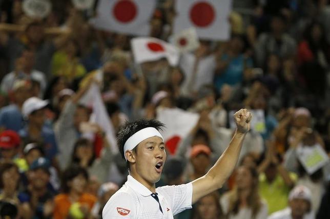 1月24日、テニスの四大大会初戦、全豪オープン男子シングルス4回戦、第7シードの錦織圭(写真)は第9シードのジョーウィルフリード・ツォンガを6─4、6─2、6─4で下した(2016年 ロイター/Issei Kato)
