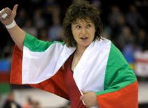 Bulgaria's Stanka Zlateva celebrates with the Bulgarian flag as she takes gold in the women's 75 kg category of the Wrestling European Championships in Vantaa, April 4, 2014. REUTERS/Timo Jaakonaho/Lehtikuva