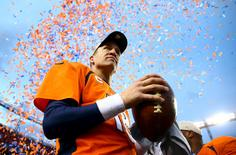 Jan 24, 2016; Denver, CO, USA; Denver Broncos quarterback Peyton Manning (18) celebrates after defeating the New England Patriots in the AFC Championship football game at Sports Authority Field at Mile High. Mandatory Credit: Mark J. Rebilas-USA TODAY Sports