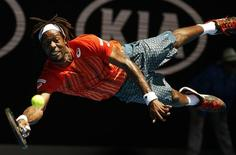 France's Gael Monfils dives for a shot during his fourth round match against Russia's Andrey Kuznetsov at the Australian Open tennis tournament at Melbourne Park, Australia, January 25, 2016. REUTERS/Issei Kato