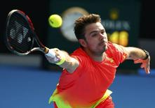 Switzerland's Stan Wawrinka stretches for a shot during his fourth round match against Canada's Milos Raonic at the Australian Open tennis tournament at Melbourne Park, Australia, January 25, 2016. REUTERS/Thomas Peter