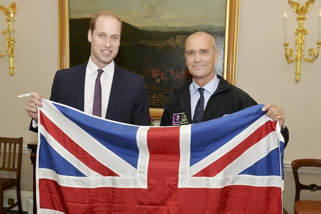 Britain's Prince William (L) holds a Union flag as he poses with explorer Henry Worsley at Kensington Palace in London, in this file photograph dated October 19, 2015.   REUTERS/John Stillwell/files
