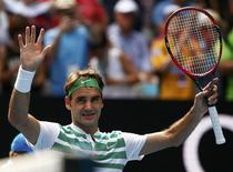 Switzerland's Roger Federer celebrates after winning his quarter-final match against Czech Republic's Tomas Berdych at the Australian Open tennis tournament at Melbourne Park, Australia, January 26, 2016. REUTERS/Thomas Peter