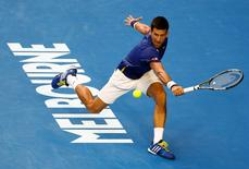 Serbia's Novak Djokovic hits a shot during his quarter-final match against Japan's Kei Nishikori at the Australian Open tennis tournament at Melbourne Park, Australia, January 26, 2016. REUTERS/Jason O'Brien Action Images via Reuters
