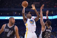 January 25, 2016; Oakland, CA, USA; Golden State Warriors center Festus Ezeli (31) shoots the basketball against San Antonio Spurs forward LaMarcus Aldridge (12) during the first quarter at Oracle Arena. Mandatory Credit: Kyle Terada-USA TODAY Sports