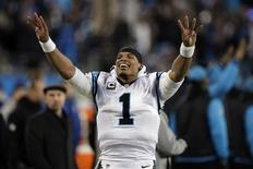 Jan 24, 2016; Charlotte, NC, USA; Carolina Panthers quarterback Cam Newton (1) celebrates on the side lines during the fourth quarter against the Arizona Cardinals in the NFC Championship football game at Bank of America Stadium. Mandatory Credit: Jeremy Brevard-USA TODAY Sports
