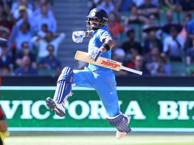 India's Virat Kohli celebrates his century against Australia during their One Day cricket match at the Melbourne Cricket Ground, January 17, 2016. REUTERS/Hamish Blair