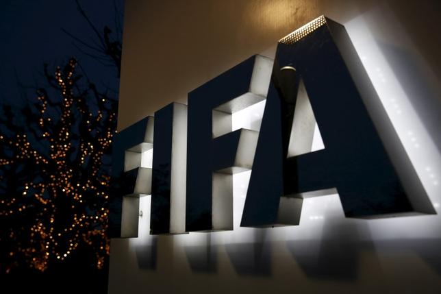 The FIFA logo is seen outside the FIFA headquarters in Zurich, Switzerland, December 17, 2015. REUTERS/Ruben Sprich