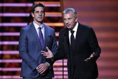 Green Bay Packers quarterback Aaron Rodgers (L) and former San Francisco 49er's quarterback Joe Montana present the NFL MVP award during the NFL Honors award show in New York February 1, 2014.  REUTERS/Carlo Allegri