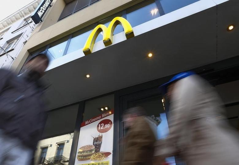 The sign for the U.S. fast food restaurant chain McDonald's is shown outside one of their restaurants in central Brussels, Belgium December 3, 2015. REUTERS/Yves Herman
