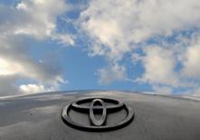 A Toyota logo is pictured on a Prius car at a Toyota dealership in west London in this February 9, 2010 file photo.  REUTERS/Toby Melville/Files