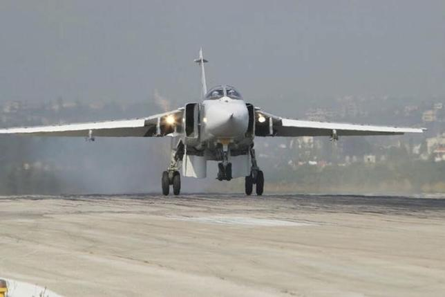 A Sukhoi Su-24 fighter jet lands at the Hmeymim air base near Latakia, Syria, in this handout photograph released by Russia's Defence Ministry November 7, 2015. REUTERS/Ministry of Defence of the Russian Federation/Handout via Reuters/Files