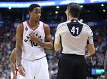 Jan 30, 2016; Toronto, Ontario, CAN; Toronto Raptors guard DeMar DeRozan (10) argues a call with NBA referee Ken Mauer (41) against the Detroit Pistons at Air Canada Centre. The Raptors beat the Pistons 111-107. Mandatory Credit: Tom Szczerbowski-USA TODAY Sports