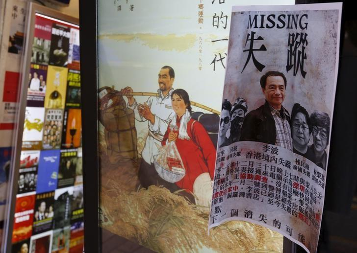 A printout showing Lee Bo, specializing in publications critical of China, and four other colleagues who went missing, is displayed outside a bookstore at Causeway Bay shopping district in Hong Kong, China January 6, 2016. REUTERS/Bobby Yip