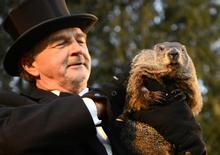 Groundhog co-handler John Griffiths holds up groundhog Punxsutawney Phil after Phil's annual weather prediction on Gobbler's Knob on the 130th Groundhog Day in Punxsutawney, Pennsylvania February 2, 2016. REUTERS/Alan Freed