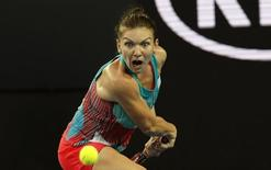 Romania's Simona Halep prepares to hit a shot during her first round match against China's Zhang Shuai at the Australian Open tennis tournament at Melbourne Park, Australia, January 19, 2016. REUTERS/Jason Reed