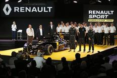 Renault Chief Executive Carlos Ghosn (2ndL), Renault Formula One racing driver Kevin Magnussen of Denmark (R) and teammate Jolyon Palmer of Britain (C) unveil the new Renault RS16 car during its official presentation at the company's research center, the Technocentre, in Guyancourt, near Paris, France, February 3, 2016. REUTERS/Benoit Tessier