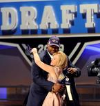 Offensive Tackle Michael Oher after being selected by the Baltimore Ravens as the 23rd overall pick in the 2009 NFL Draft.  REUTERS/Ray Stubblebine