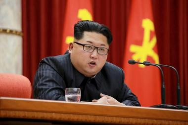 North Korean leader Kim Jong Un speaks during a ceremony at the meeting...