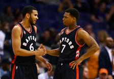 Feb 2, 2016; Phoenix, AZ, USA; Toronto Raptors guard Kyle Lowry (7) celebrates with guard Cory Joseph (6) in the closing seconds of the game against the Phoenix Suns at Talking Stick Resort Arena.  Mandatory Credit: Mark J. Rebilas-USA TODAY Sports