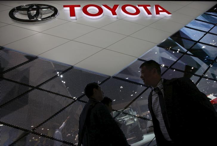 Visitors walk at Toyota Motor Corp's booth at the 44th Tokyo Motor Show in Tokyo, Japan, November 5, 2015. REUTERS/Issei Kato